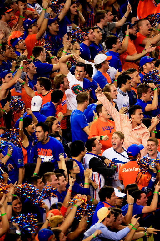 . ARLINGTON, TX - APRIL 05:  Florida Gators fans cheer during the NCAA Men\'s Final Four Semifinal against the Connecticut Huskies at AT&T Stadium on April 5, 2014 in Arlington, Texas.  (Photo by Jamie Squire/Getty Images)