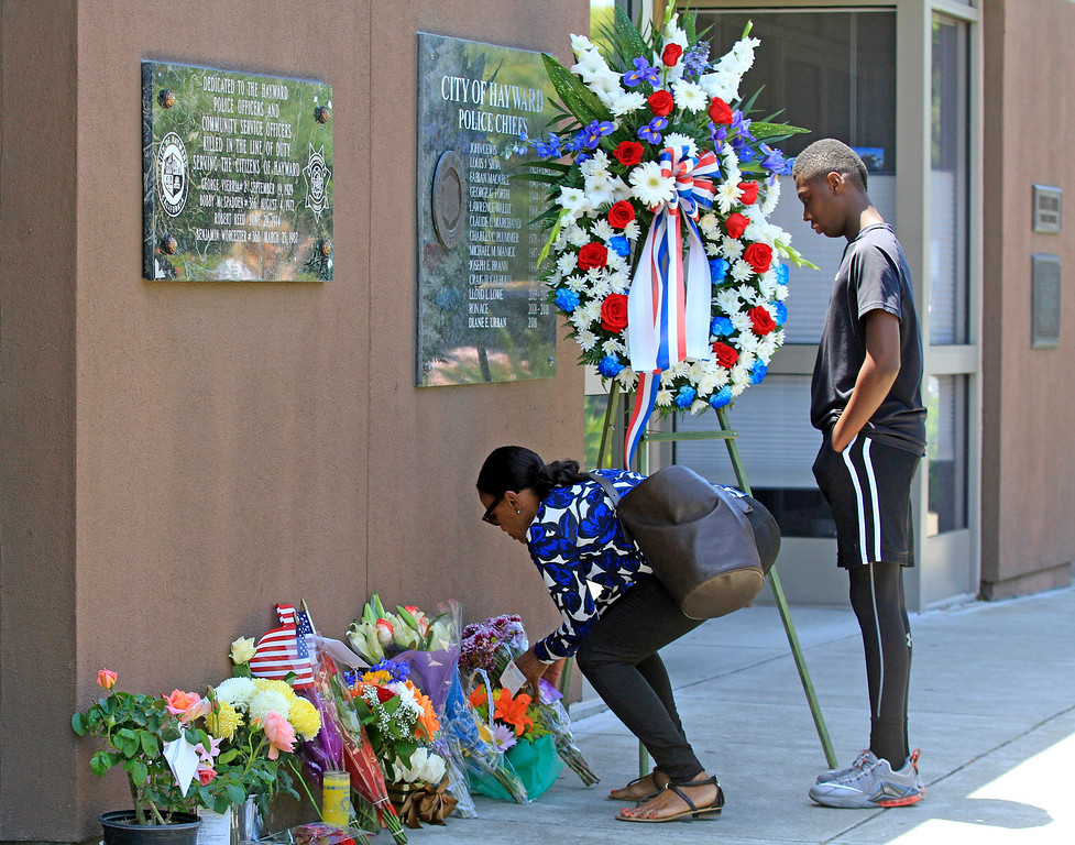 . Flowers and cards of condolences for fallen Sgt. Scott Lunger are piling up outside the Hayward Police Department in Hayward, Calif., on Wednesday, July 22, 2015. Lunger  was shot and killed early Wednesday morning during a routine traffic stop. (Laura A. Oda/Bay Area News Group)