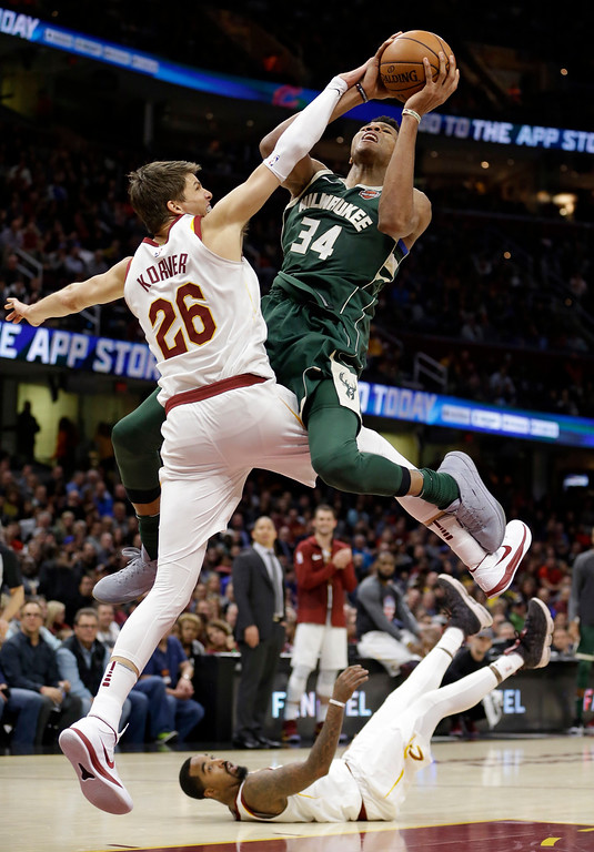 . Milwaukee Bucks\' Giannis Antetokounmpo (34), from Greece, drives to the basket against Cleveland Cavaliers\' Kyle Korver (26) in the second half of an NBA basketball game, Tuesday, Nov. 7, 2017, in Cleveland. JR Smith watches from the floor. The Cavaliers won 124-119. (AP Photo/Tony Dejak)