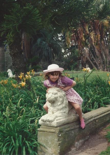 Devon - on lion statue.jpeg