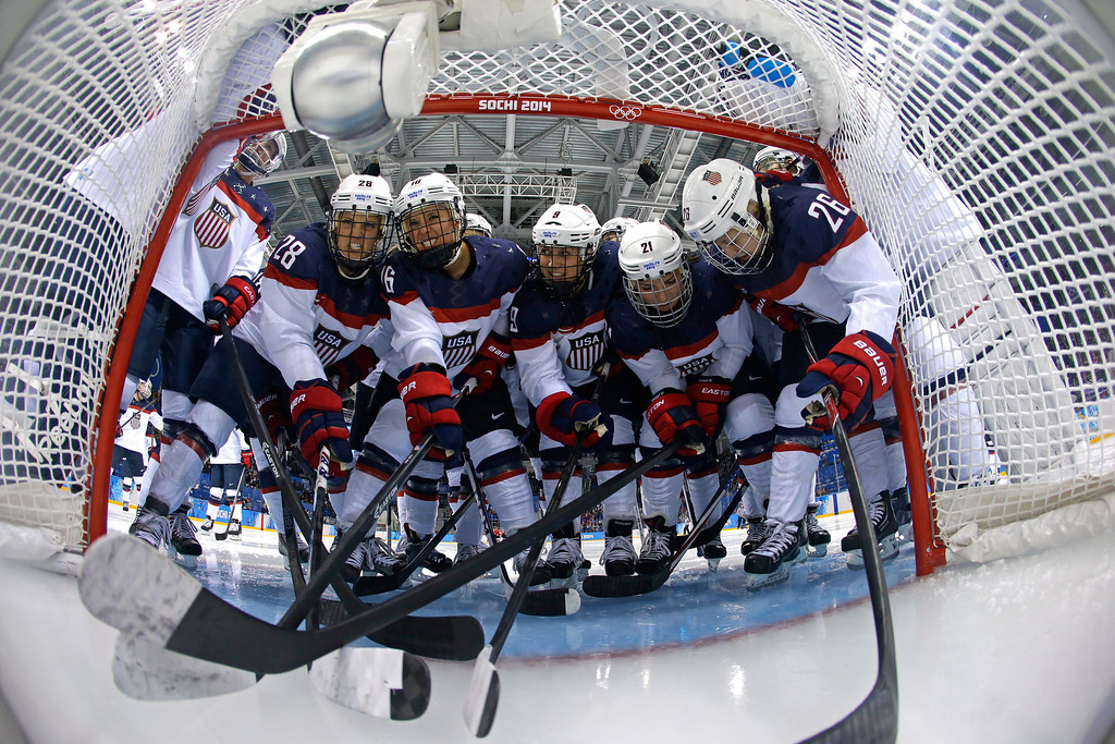 . The the United States team huddles in front of the net prior to the Women\'s Ice Hockey Preliminary Round Group A game against Canada on day five of the Sochi 2014 Winter Olympics at Shayba Arena on February 12, 2014 in Sochi, Russia.  (Photo by Matt Slocum - Pool/Getty Images)