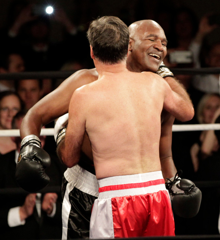 ". Mitt Romney, (R) and Evander Holyfield (L), hug after a charity boxing event on May 15, 2015 in Salt Lake City, Utah.The event was held to raise money for  ""Charity Vision\"" a charity that aims to restore sight to the blind and visually impaired. (Photo by George Frey/Getty Images)"