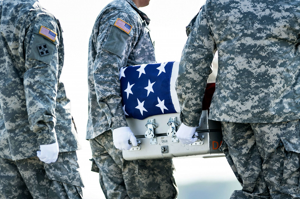 . A US Army carry team moves a transfer case with the remains of US Army Maj. Gen. Harold J. Greene from a C-17 cargo plane during a dignified transfer at Dover Air Force Base August 7, 2014 in Delaware. AFP PHOTO/Brendan SMIALOWSKI/AFP/Getty Images