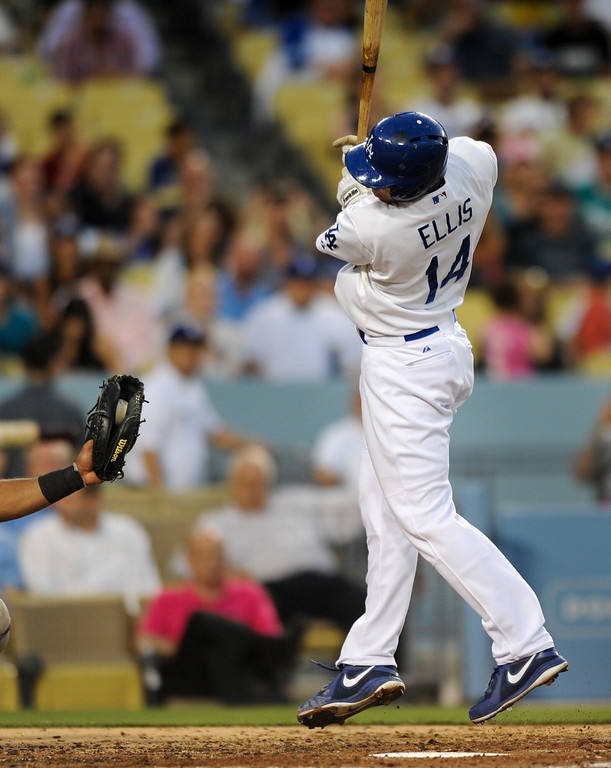. Dodger Mark Ellis jumps back from an inside pitch by the Rockies\' Juan Nicasio, Friday, July 12, 2013, at Dodger Stadium. (Michael Owen Baker/Staff Photographer)