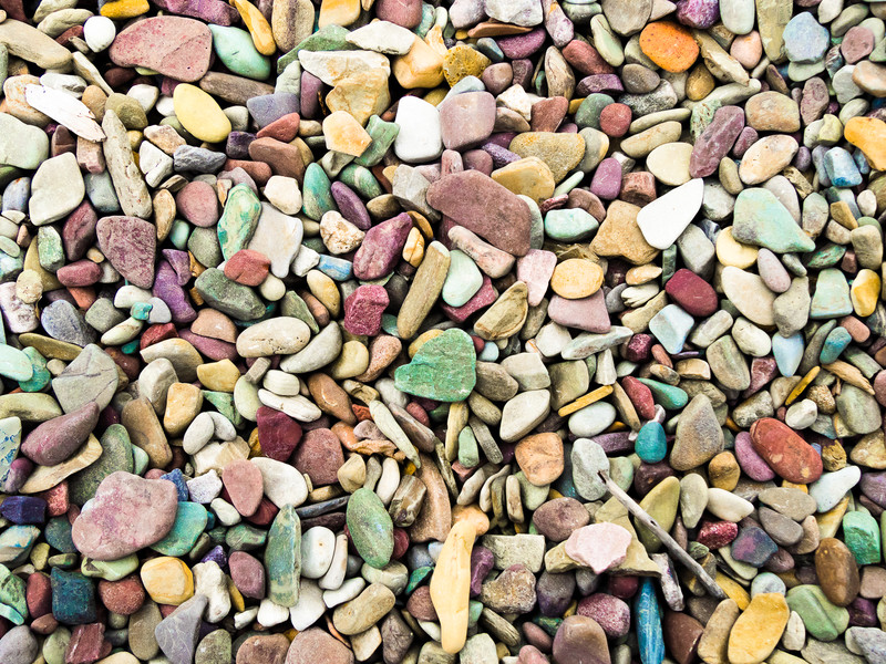 Colored Water Worn Rocks in Clear Water
