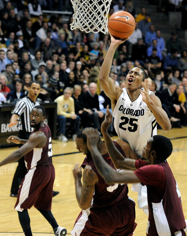 . University of Colorado\'s Spencer Dinwiddie takes a shot over a swarm of defenders during a game against Texas Southern on Tuesday, Nov. 27, at the Coors Event Center on the CU campus in Boulder.  Jeremy Papasso/ Camera