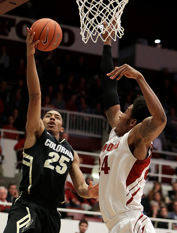 . Colorado\'s Spencer Dinwiddie (25) shoots against Stanford\'s Josh Huestis during the first half of an NCAA college basketball game Wednesday, Feb. 27, 2013, in Stanford, Calif. (AP Photo/Ben Margot)