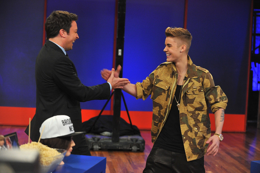 """. NEW YORK, NY - FEBRUARY 05:  Justin Bieber and Jimmy Fallon interaction during a taping of \""""Late Night With Jimmy Fallon\"""" at Rockefeller Center on February 5, 2013 in New York City.  (Photo by Theo Wargo/Getty Images)"""