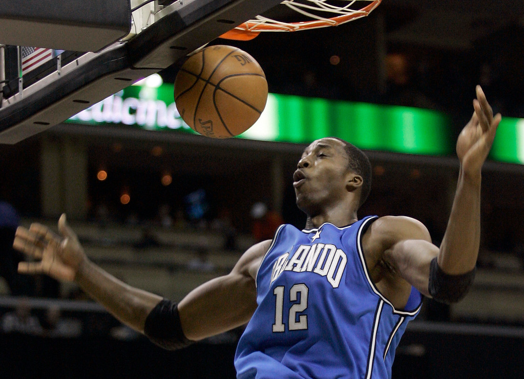 . Orlando Magic forward Dwight Howard (12)  reacts after a dunk during the second half of the Magic\'s 103-87 win over the Charlotte Bobcats in an NBA basketball game in Charlotte, N.C., Friday, Dec. 14, 2007. (AP Photo/Chuck Burton)