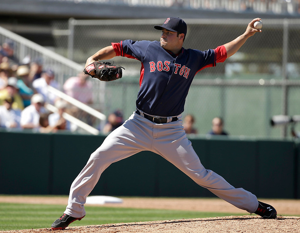 . Boston Red Sox pitcher Noe Ramirez delivers a warm-up throw in the second inning of an exhibition baseball game against the Minnesota Twins, Saturday, March 1, 2014, in Fort Myers, Fla. (AP Photo/Steven Senne)