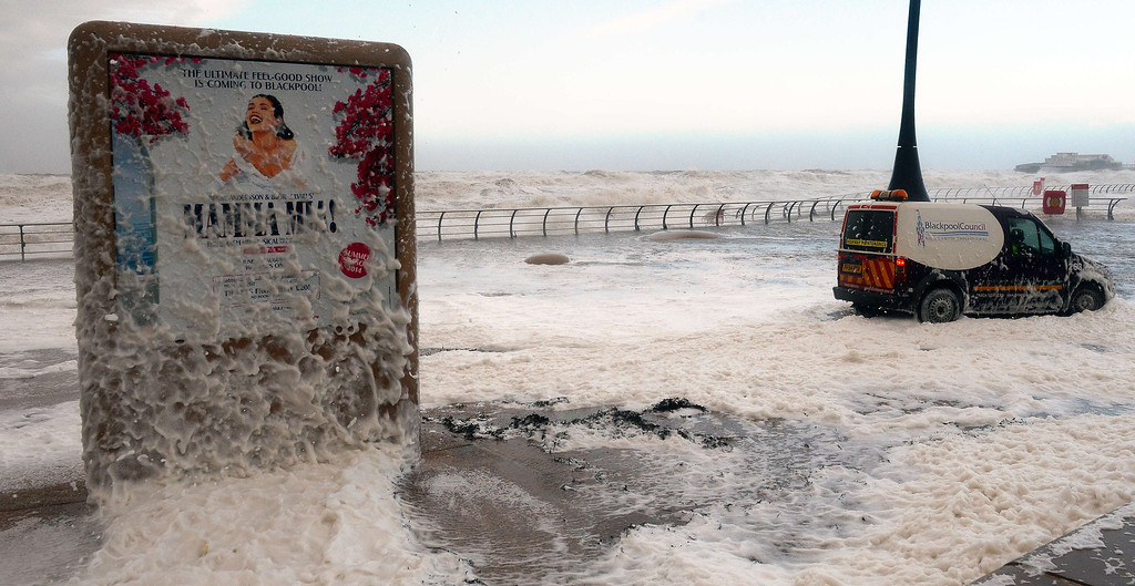 . The tide turns to froth by the Lifeboat Station on the promenade in Blackpool, north west England, on December 5, 2013 as high winds hit the north of England and Scotland. AFP PHOTO / PAUL ELLIS/AFP/Getty Images
