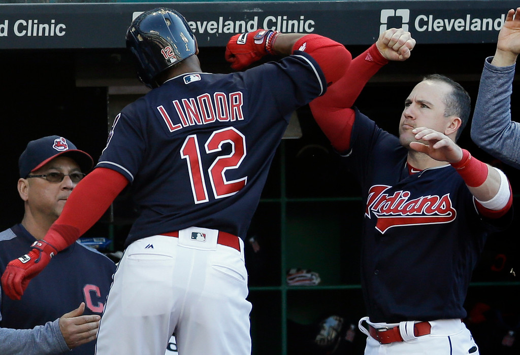 . Cleveland Indians\' Daniel Robertson, right, congratulates Francisco Lindor after Lindor hit a solo home run off Oakland Athletics starting pitcher Sean Manaea in the fourth inning of a baseball game, Wednesday, May 31, 2017, in Cleveland. (AP Photo/Tony Dejak)