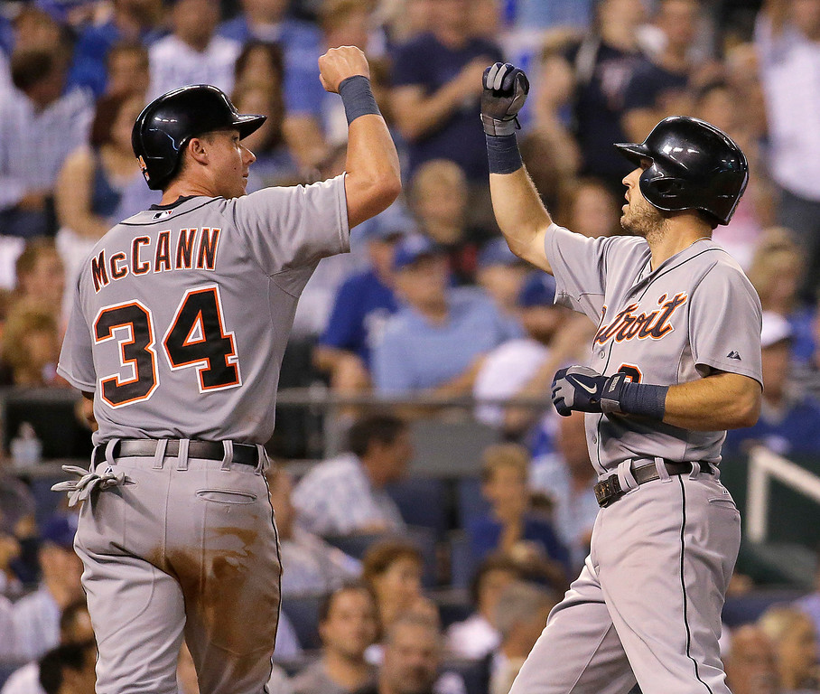 . Detroit Tigers\' Ian Kinsler, right, and James McCann (34) celebrate after Kinsler hit a two-run home run during the fifth inning of a baseball game against the Kansas City Royals on Friday, Sept. 19, 2014, in Kansas City, Mo. (AP Photo/Charlie Riedel)