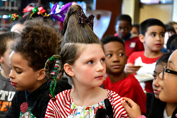 12/20/2018 Mike Orazzi | Staff Madalyn Bouchard listens to Bristol Mayor Ellen Zoppo-Sassu as she reads to 3rd grade children at the West Bristol School during their Grinchmas, a month-long celebration of literacy events and community services on Thursday afternoon.