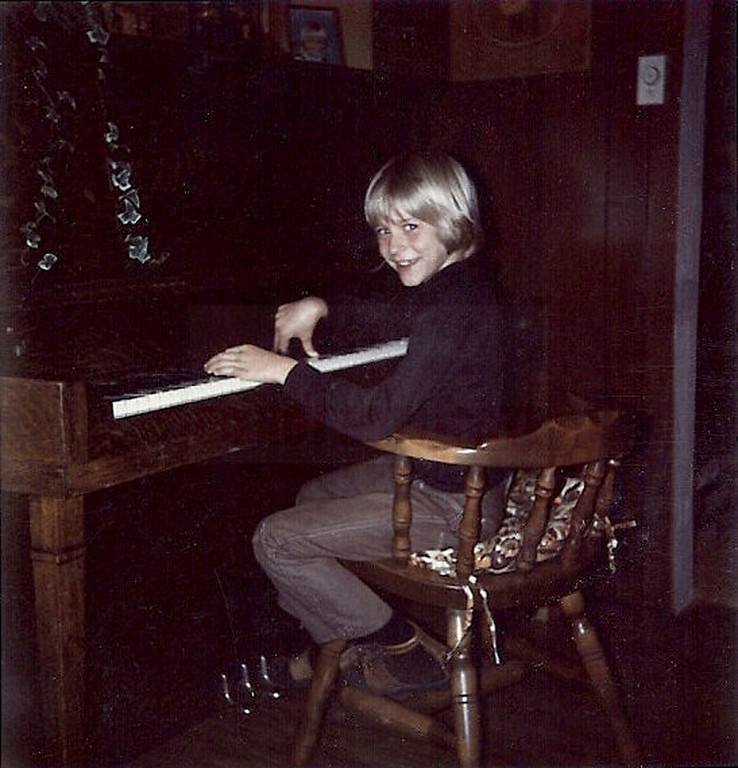 . In this undated photo provided by Kim Cobain, a young Kurt Cobain plays piano in his childhood home in Aberdeen, Wash.   (AP Photo/Courtesy Kim Cobain)