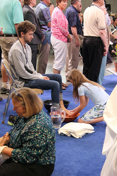 Worship attendees move to various stations during the service.