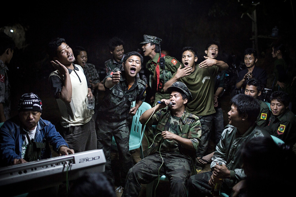 . This picture by German photographer Julius Schrank for de Volkskrant won 1st Prize in Daily Life Singles category of the 57th World Press Photo Contest, it was announced by the organizers in Amsterdam, The Netherlands, 14 February 2014. It shows Kachin Independence Army fighters drinking and celebrating at a funeral of one of their commanders who died that day before. The city is under siege by the Burmese army.  EPA/JULIUS SCHRANK / DE VOLKSKRANT