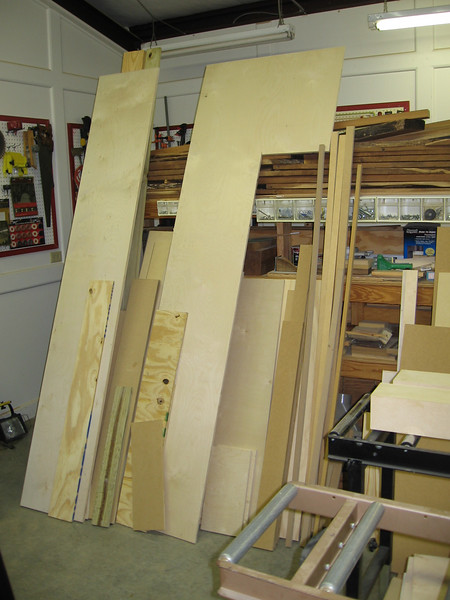 Plywood and mdf scraps from previous projects. Hardwood storage on horizontal racks.