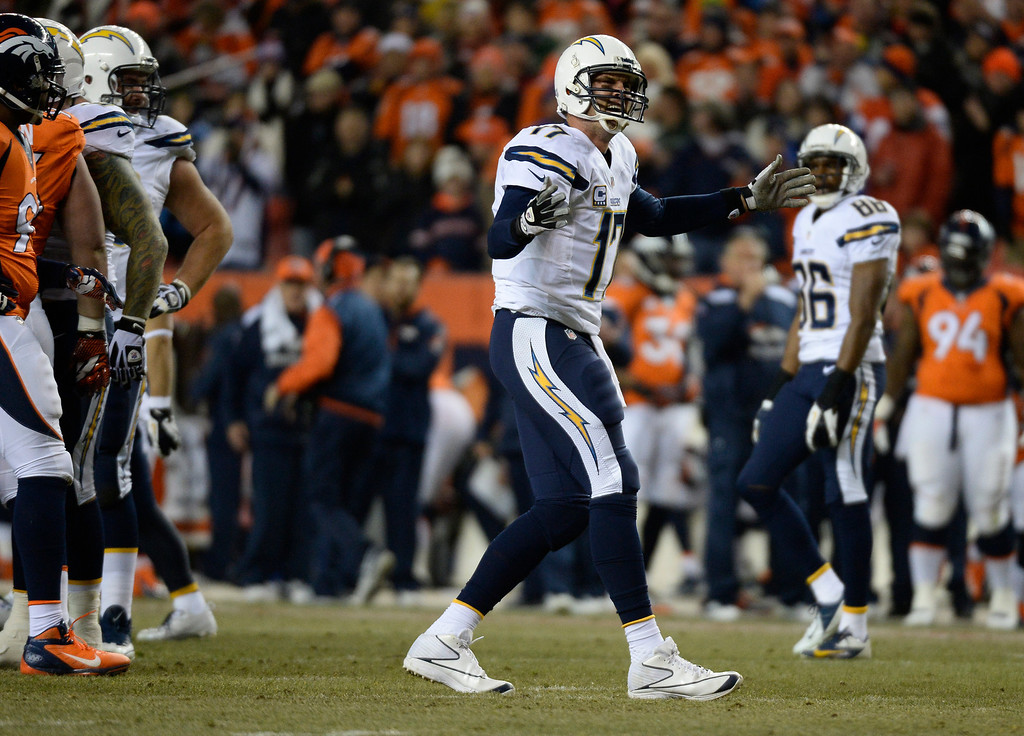 . San Diego Chargers quarterback Philip Rivers (17) complaining after getting sacked during the first quarter. The Denver Broncos vs. the San Diego Chargers at Sports Authority Field at Mile High in Denver on December 12, 2013. (Photo by John Leyba/The Denver Post)