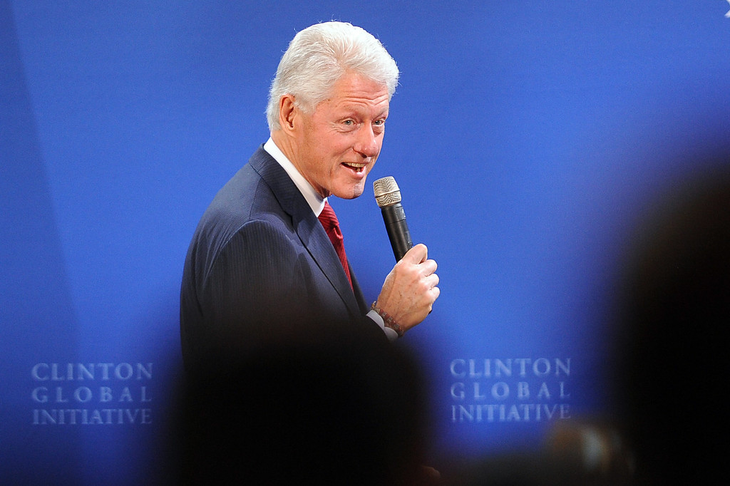 . President Bill Clinton takes the stage during the Clinton Global Initiative infrastructure meeting at LA City Hall Thursday, April 3, 2014.  The meeting was the fifth convened by President Clinton with mayors to discuss infrastructure in their cities.(Andy Holzman/Los Angeles Daily News)