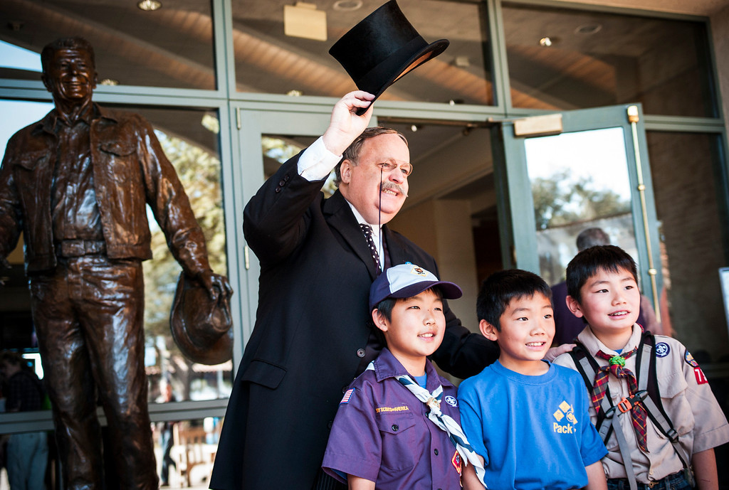 . Teddy Roosevelt, portrayed by Brian Patrick Mulligan, waves as he poses with Quinn Yamamoto, Jacob Choi and Aydan Yamamoto, all from cub scout pack 737 in Diamond Bar on Presidents Day at the Ronald Reagan Presidential Library in Simi Valley, CA on February 17, 2014.   (Photo by David Crane/Los Angeles Daily News)