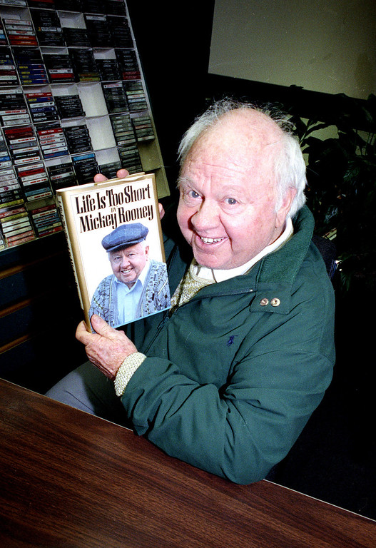 ". Mickey Rooney holds his autobiography, ""Life Is Too Short,\"" during a book signing at a bookstore in New York City on April 1, 1991.  Rooney, 70, has been married eight times, appeared on Broadway and has made 150 films.  (AP Photo/David Cantor)"