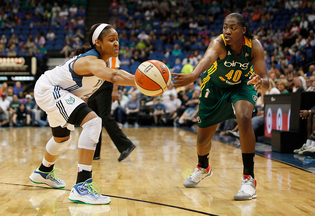 . Minnesota Lynx forward Maya Moore (23) knocks away a pass made by Seattle Storm guard Shekinna Stricklen (40) in the second half of a WNBA basketball game, Sunday, Aug. 4, 2013, in Minneapolis. The Lynx won 90-72. (AP Photo/Stacy Bengs)