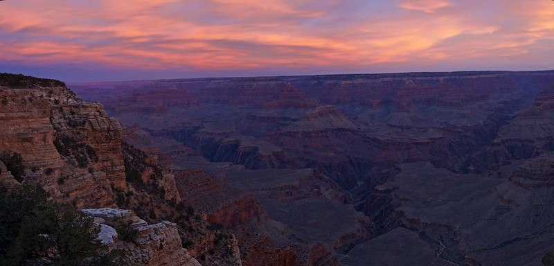 "JUST ANOTHER SUNRISE IN ARIZONA - 4 December 2014  Sunrise on Mather Point - Grand Canyon National Park, AZ, File #1424387  Link to larger file:  http://www.tom-hill.biz/Galleries/Scenics/Arizona/i-RkbkfpZ/A __________  This image was taken the last morning of my recent trip to the Grand Canyon.  I confess, it was really difficult getting out of bed.  Almost so much that I would've missed this shot--and a couple others.  I remember thinking in bed just prior to the alarm going on, ""I got plenty of great images this trip.  I can just sleep in bed and be great.""  Well, I stayed in bed but I didn't get to sleep.  In fact, I kept thinking about my decision process of staying in bed.  Eventually, I was thinking so much about it I became more awake than when I first woke.  That made the decision for me.  If I'm not going to sleep I might as well get up, which is precisely what I did.  You can tell from this image there were 20 of my best friends I never met before within 10 feet of me squished against the railing at the tip of Mather Point.  If you've been out there you know there's a lot of space on this gigantic rock and piece of concrete.  All that room didn't mean there was plenty of space for all of us.  Nope, if you were where people thought the action was, then there was no space for you.  All I can say is at least the young lady to the right of me was considerate enough not to bump my tripod leg as it shot this image.  Just to be clear, I never say anything to anyone when they get near me at a very popular place.  In fact, if I've gotten most of what I need, I normally move if someone asks me nicely.  As much as I might belly ache about people walking into the middle of my shot after having been clearly set up without so much of a ""hey, how are you"" from them, I don't say anything.  I figure it's better that way.  In the end, I get the picture I want which is usually something completely different than what the average tourist is seeking.  And, I don't need the bad ""chi"" for having been snarky first thing in the morning.  TI think the clouds in this image made it.  Without them, the light on the rocks would be totally different and the sky wouldn't look nearly as interesting.  Without the clouds, this image wouldn't have worked out.    Cheers  Tom"
