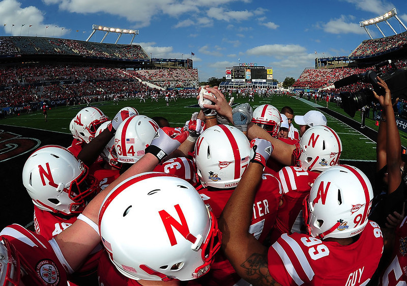 . Members of the Nebraska Cornhuskers huddle before the Capital One Bowl against the Georgia Bulldogs at the Citrus Bowl on January 1, 2013 in Orlando, Florida. (Photo by Scott Cunningham/Getty Images)