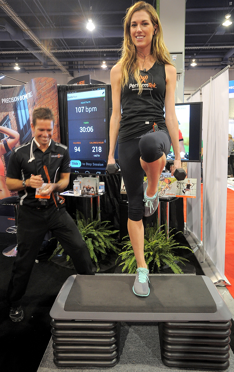 . Margot\'s pulse and callories are monitored by PerformTech earbuds made by Valencell at the Las Vegas Convention Center on January 9, 2013 in Las Vegas, Nevada. (JOE KLAMAR/AFP/Getty Images)