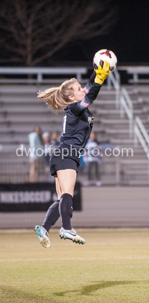 Adelaide Gay of the Washington Spirit does a two handed flying grab to end a UNC attack on goal.