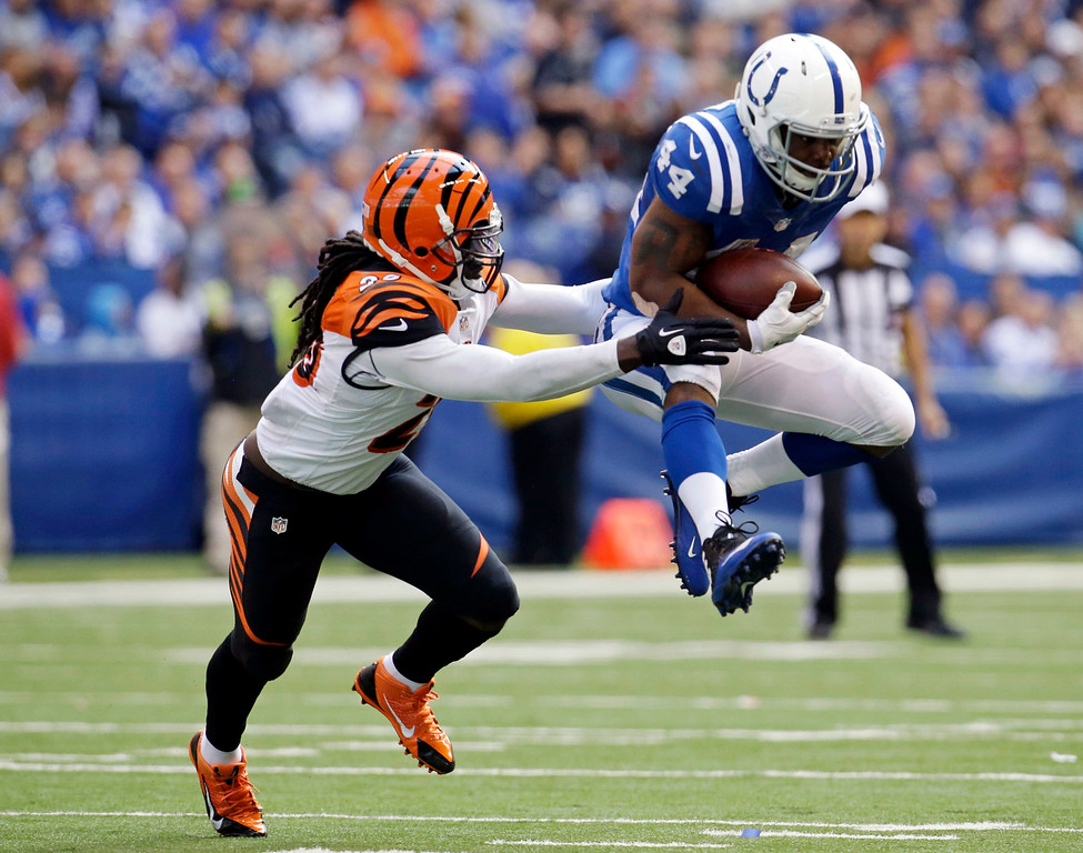 . Indianapolis Colts running back Ahmad Bradshaw (44) is tackled by Cincinnati Bengals free safety Reggie Nelson (20) during the second half of an NFL football game Sunday, Oct. 19, 2014, in Indianapolis. (AP Photo/AJ Mast)