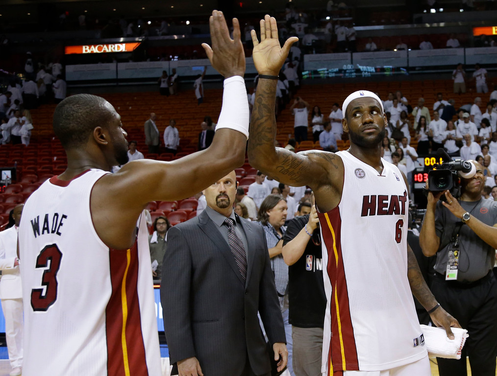 . Miami Heat small forward LeBron James (6) is congratulated by  Dwyane Wade (3) after defeated the Indiana Pacers in Game 1 in their NBA basketball Eastern Conference finals playoff series, Wednesday, May 22, 2013 in Miami. The Heat won 103-102 in overtime. (AP Photo/Lynne Sladky)