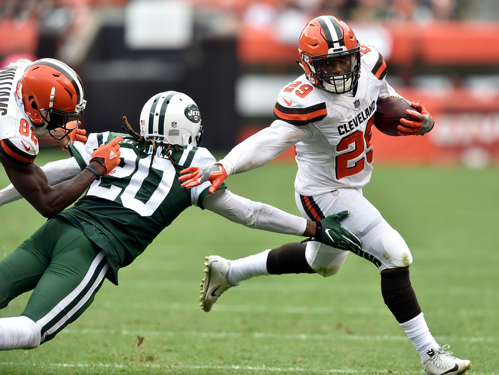 . Cleveland Browns running back Duke Johnson (29) avoids a tackle by New York Jets cornerback Marcus Williams (20) as he scores a 41-yard touchdown during the second half of an NFL football game, Sunday, Oct. 8, 2017, in Cleveland. (AP Photo/David Richard)