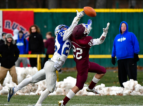 11/23/2018 Mike Orazzi   Staff Bristol Eastern's Jaden Laprise (25) and Central's Victor Rosa (22) during the Battle for the Bell at Muzzy Field Friday. Central won 24-19.