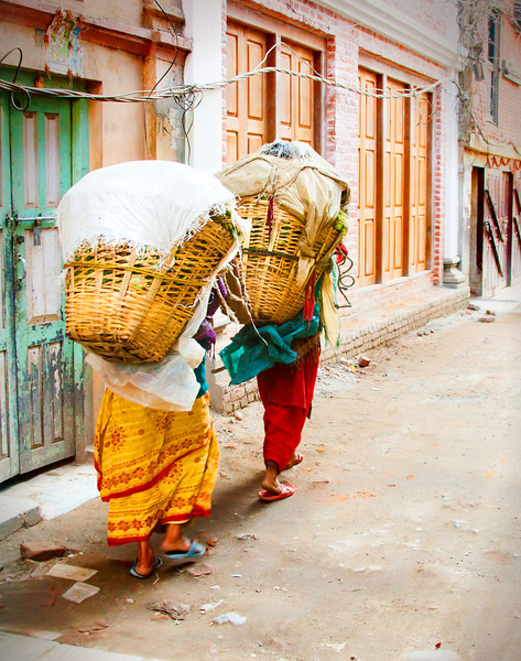 Women in Nepal Carrying Baskets