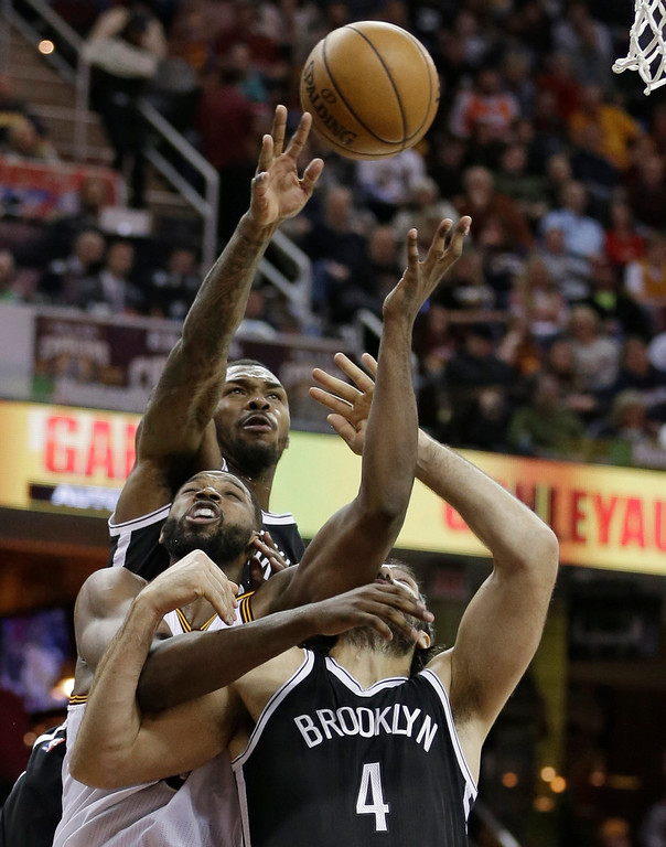 . Brooklyn Nets\' Luis Scola, Cleveland Cavaliers\' Tristan Thompson and and Nets\' Sean Kilpatrick go up for a rebound during the second half of an NBA basketball game, Friday, Jan. 27, 2017, in Cleveland. (AP Photo/Tony Dejak)