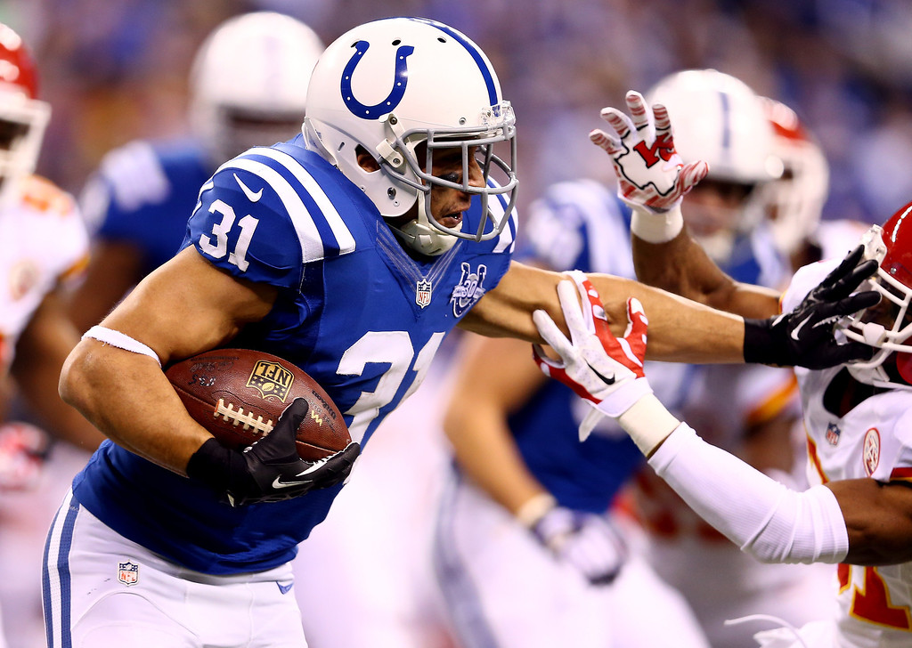. INDIANAPOLIS, IN - JANUARY 04:  Running back Donald Brown #31 of the Indianapolis Colts carries the ball against the Kansas City Chiefs during a Wild Card Playoff game at Lucas Oil Stadium on January 4, 2014 in Indianapolis, Indiana.  (Photo by Andy Lyons/Getty Images)