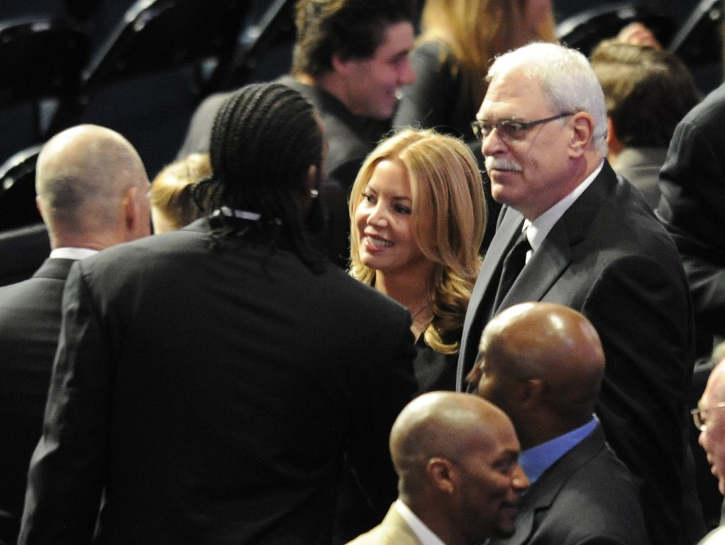 . Ronny Turiaf talks with Jeanie Buss and Phil Jackson. Family, friends current and former Lakers players and coaches attended a memorial service at the Nokia Theatre for Laker owner Jerry Buss who passed away on Monday, 2/18/2013 as a result of cancer. Los Angeles, CA 2/21/2013 John McCoy/Staff Photographer