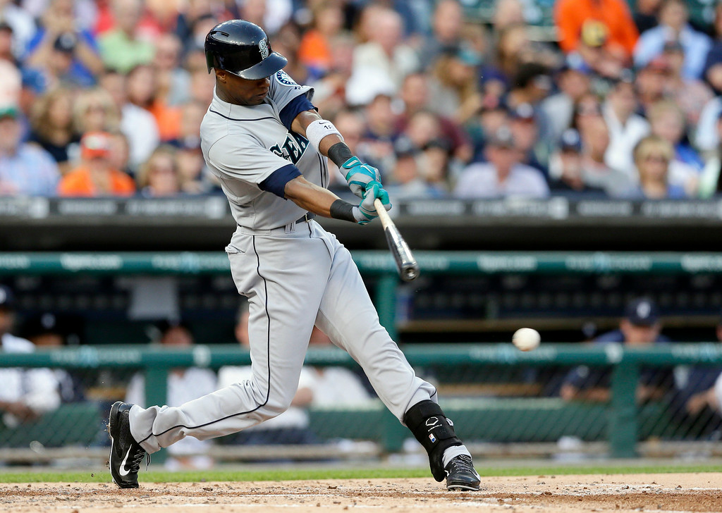. Seattle Mariners\' Austin Jackson hits into a double play but scores teammate Logan Morrison during the second inning of a baseball game against the Detroit Tigers, Friday, Aug. 15, 2014 in Detroit. (AP Photo/Carlos Osorio)
