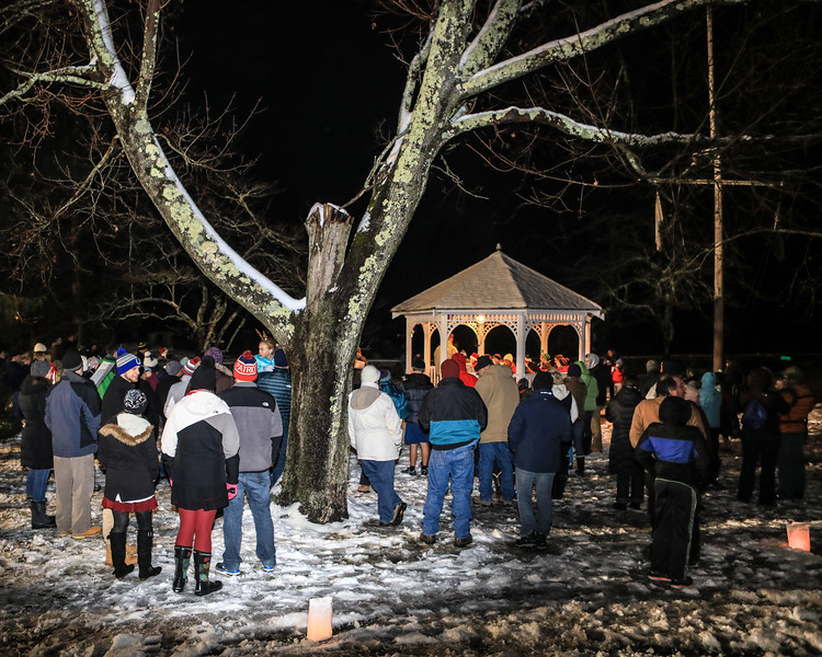 The crowd attending the annual The Kingston Luminaries gather around the band stand to sing Christmas Carols and followed by Christmas Tree lighting. Wicked Local Photo/Denise Maccaferri