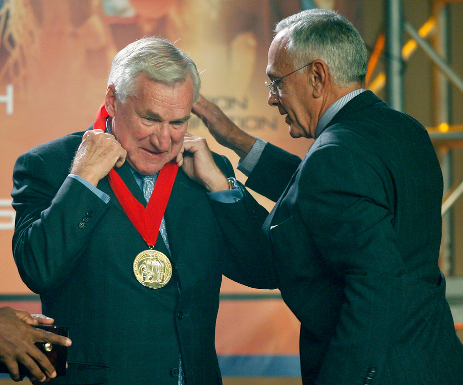 ". FILE - In a Nov. 19, 2006, file photo, Larry Brown, right, presents former North Carolina head basketball coach, Dean Smith, with a medal during Smith\'s induction into the National Collegiate Basketball Hall of Fame in Kansas City, Mo. Smith, the North Carolina basketball coaching great who won two national championships, died ""peacefully\"" at his home Saturday night, Feb. 7, 2015, the school said in a statement Sunday from Smith\'s family. He was 83. (AP Photo/Ed Zurga, File)"