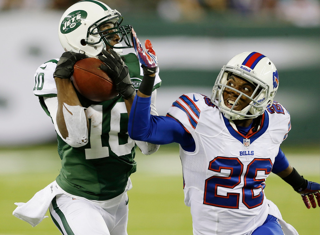 . New York Jets\' Santonio Holmes (10) catches a pass for a touchdown as Buffalo Bills defensive back Justin Rogers (26) defends during the second half of an NFL football game Sunday, Sept. 22, 2013, in East Rutherford, N.J. (AP Photo/Seth Wenig)