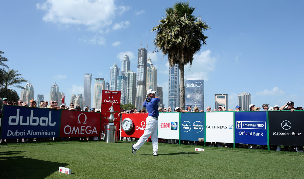 Description of . Lee Westwood of England tees off on the first hole during the final round of the Omega Dubai Desert Classic at Emirates Golf Club on February 3, 2013 in Dubai, United Arab Emirates.  (Photo by Warren Little/Getty Images)