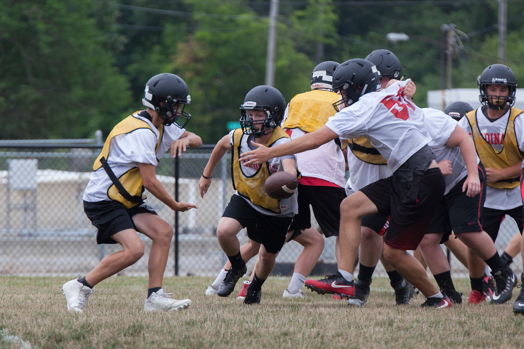 . Jen Forbus - The Morning Journal<br> The Brookside squad runs through plays on the Cardinals\' first day of football practice on July 30.