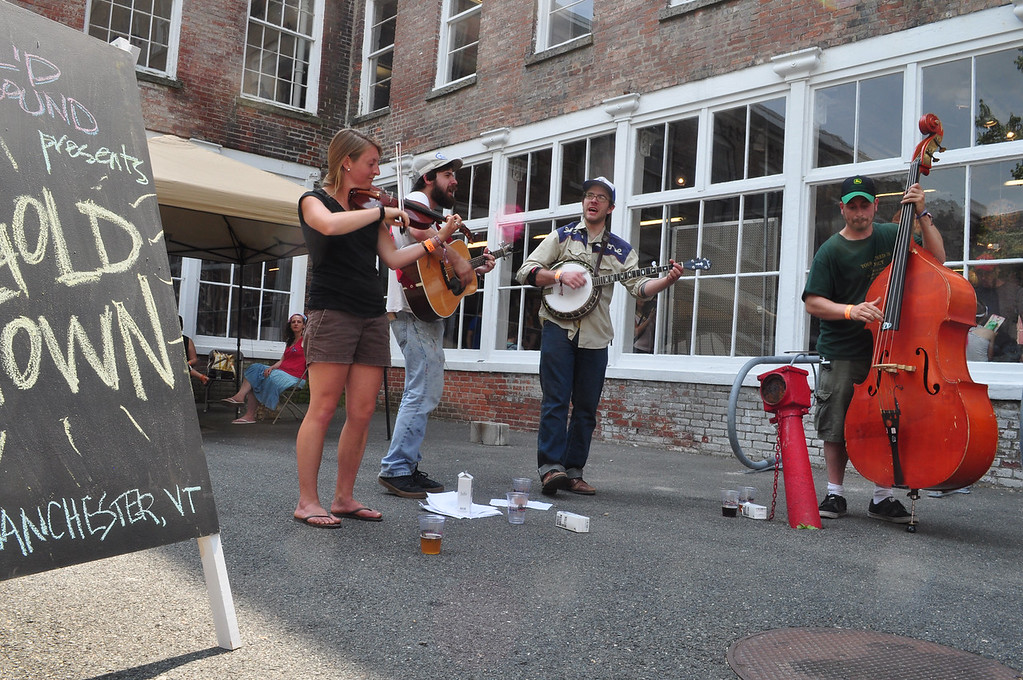 . Jack Guerino/ North Adams Transcript Gold Town plays bluegrass music outside of MASS MoCA.