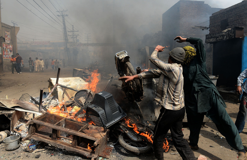 . Angry Pakistani demonstrators torch Christian\'s belongings during a protest over a blasphemy row in a Christian neighborhood in Badami Bagh area of Lahore on March 9, 2013. Thousands of angry protestors on March 9 set ablaze more than 100 houses of Pakistani Christians over a blasphemy row in the eastern city of Lahore, officials said. Over 3,000 Muslim protestors turned violent over derogatory remarks allegedly made by a young Christian, Sawan Masih, 28 against Prophet Muhammad in a Christian neighboorhood in Badami Bagh area. Arif Ali/AFP/Getty Images