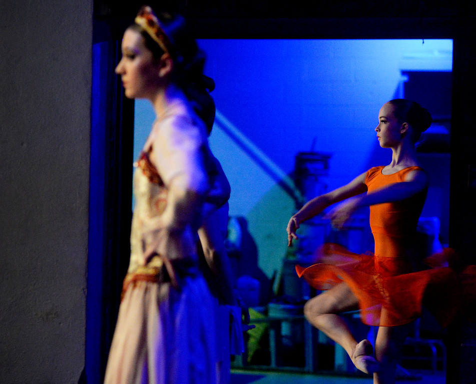 . Isabella Northburg, 14, right, warmups backstage as hundreds of ballet dancers came to The Theater at Colorado Heights University in Denver to compete in the Youth America Grand Prix Regional semi-finals on Friday, February 19, 2016. The weekend competition was for dancers to earn scholarships and invitations to prestigious dance companies.    (Photo by Cyrus McCrimmon/ The Denver Post)