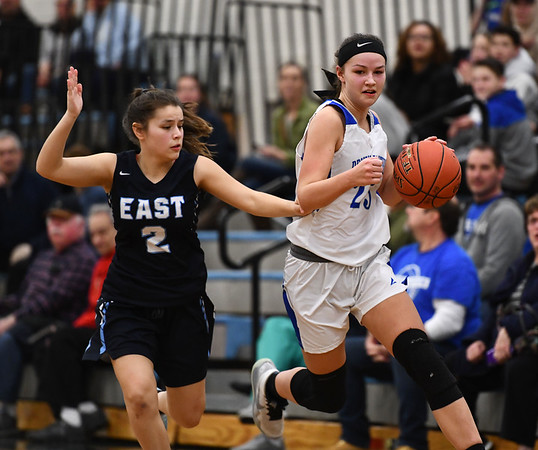 2/18/2020 Mike Orazzi | StaffrBristol Eastern's Sage Scarritt (25) and East Catholic's Kayliana Salazar (2) during a 57-52 Eastern overtime win in Bristol Tuesday afternoon.