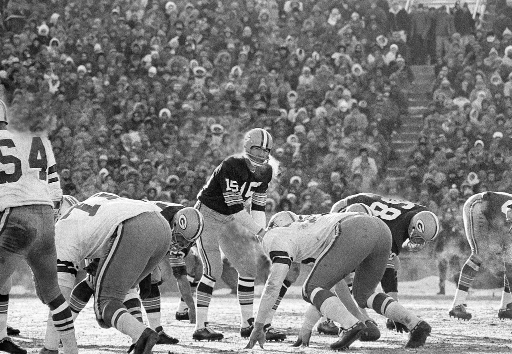 . His face wreathed with steam from his breath, Green Bay Packers quarter Bart Starr calls signals in bitter cold as he led the Packers to a 21-14 win over the Dallas Cowboys to capture third consecutive National Football League title, Dec. 31, 1967 in Green Bay. Starr tossed two touchdown passes and scored the winning touchdown himself with seconds to play in the game at Green Bay. (AP Photo)